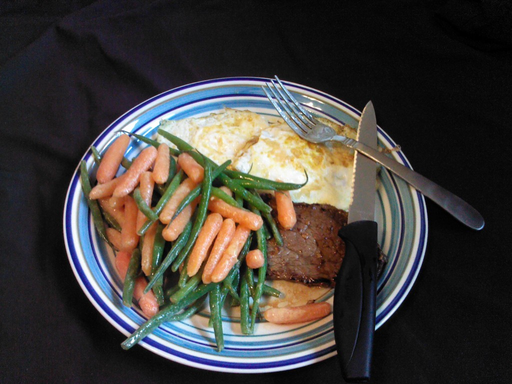 Steak, eggs, and vegetables in a Dijon sauce